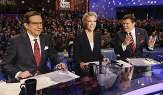 FOX News debate moderators (L-R) Chris Wallace, Megyn Kelly and Bret Baier wait for the start of the Republican presidential primary debate, Thursday, Jan. 28, 2016, in Des Moines, Iowa. (AP Photo/Charlie Neibergall)