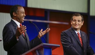 Republican presidential candidate retired neurosurgeon Ben Carson answers a question as Sen. Ted Cruz, R-Texas, looks on during a Republican presidential primary debate, Thursday, Jan. 28, 2016, in Des Moines, Iowa. (AP Photo/Charlie Neibergall) ** FILE **