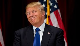 Republican presidential candidate Donald Trump smiles while speaking at a rally at Drake University in Des Moines, Iowa, Thursday, Jan. 28, 2016. (AP Photo/Andrew Harnik)