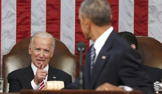 FILE - In this Jan. 12, 2016 file-pool photo, Vice President Joe Biden points at President Barack Obama during the president's State of the Union address to a joint session of Congress on Capitol Hill in Washington. President Barack Obama is creating a new federal task force to accelerate cancer research. He's tapping Biden to chair the effort. Obama signed a presidential memorandum Thursday, Jan. 28, 2016, establishing the White House Cancer Moonshot Task Force. (AP Photo/Evan Vucci, Pool, File)