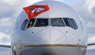 The plane carrying the Denver Broncos arrives at Mineta San Jose International Airport for the NFL Super Bowl football game Sunday, Jan. 31, 2016, in San Jose, Calif.  The Broncos play the Carolina Panthers on Sunday, Feb. 7, 2015, in Super Bowl 50. (AP Photo/Charlie Riedel)