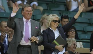"FILE - In this June 28, 2008 file photo, Terry Wogan and Jennifer Saunders are introduced to the crowd from Royal Box on the Centre Court at Wimbledon.   Wogan, one of the best-known voices and faces on British television and radio, has died aged 77. His family said in a statement Wogan died Sunday, Jan. 31, 2016  surrounded by family members ""after a short but brave battle with cancer."" (AP Photo/Anja Niedringhaus)"
