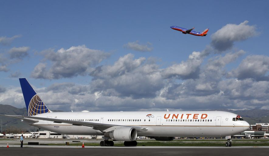 The plane carrying the Denver Broncos arrives at Mineta San Jose International Airport for the NFL Super Bowl football game Sunday, Jan. 31, 2016, in San Jose, Calif.  The Broncos play the Carolina Panthers on Sunday, Feb. 7, 2015, in Super Bowl 50. (AP Photo/Morry Gash)