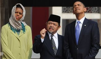President Obama (right) and first lady Michelle Obama are led on a tour by Grand Imam Ali Mustafa Yaqub at the Istiqlal Mosque in Jakarta, Indonesia, on Nov. 10, 2010. (Associated Press) **FILE**