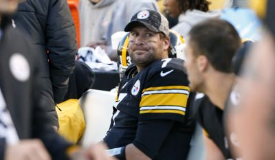 FILE - In this Nov. 8, 2015, file photo, Pittsburgh Steelers quarterback Ben Roethlisberger (7) sits on  the bench after being injured in an NFL football game against the Oakland Raiders, in Pittsburgh. Roethlisberger says he had a migraine. Mike Tomlin says the Steelers quarterback has a concussion. Either way, Roethlisberger will remain under the concussion protocol this week as the Steelers prepare to face Indianapolis. Roethlisberger left Sunday's, Dec. 29, 2015, loss to Seattle in the fourth quarter after self-reporting a potential concussion.  (AP Photo/Gene J. Puskar, File)
