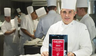 Chef Benoit Violier poses with the certificate as Chef of the year in his kitchen in the Hotel de Ville in Crissier, Switzerland, in this Oct. 8, 2012, file photo. Swiss police said Monday, Feb. 1, 2016, 3-star chef Violier, whose restaurant near Lausanne recently topped a list of the world's best, has been found dead of an apparent self-inflicted gunshot. (Jean-Christophe Bott/Keystone via AP)