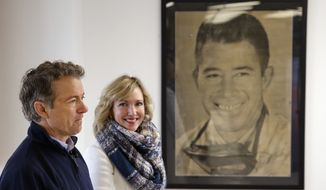 Republican presidential candidate, Sen. Rand Paul, R-Ky., with his wife, Kelley, waits to be introduced during a town hall at National Sprint Car Hall of Fame and Museum in Knoxville, Iowa, Friday, Jan. 29, 2016. (AP Photo/Patrick Semansky)