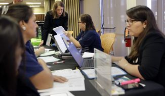 U.S. Department of Health and Human Services Secretary Sylvia M. Burwell (center) tours a health insurance enrollment event at Southwest General Hospital in San Antonio on Jan. 29, 2016. Burwell was in San Antonio to encourage residents to enroll in health coverage through the federal marketplace. (Associated Press)