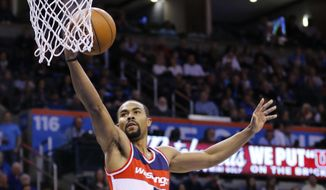Washington Wizards guard Ramon Sessions (7) goes up for a basket over Oklahoma City Thunder guard Cameron Payne (22) during the first quarter of an NBA basketball game in Oklahoma City, Monday, Feb. 1, 2016. (AP Photo/Alonzo Adams)