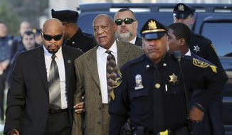 Actor and comedian Bill Cosby, center, arrives for a court appearance Tuesday, Feb. 2, 2016, in Norristown, Pa. Cosby was arrested and charged with drugging and sexually assaulting a woman at his home in January 2004. (AP Photo/Mel Evans)