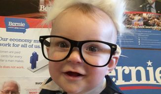 Here's a photo of Easton Uhl, eight months old, who attended the Democratic caucus at Franklin Elementary School in Council Bluffs, Iowa. Photo by Carolyn Hendrix-Uhl.