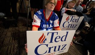 Supporters listen as Republican presidential candidate, Sen. Ted Cruz, R-Texas, speaks during a campaign event, Saturday, Jan. 30, 2016, in Ames, Iowa. (AP Photo/Mary Altaffer)