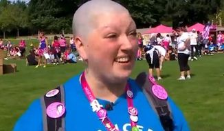 Tracy Dart, a well-known Seattle cancer survivor who raised more than $400,000 for the Susan G. Komen Foundation, is accused of faking her disease. (KOMO News)