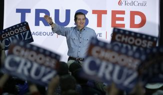 Republican presidential candidate, Sen. Ted Cruz, R-Texas, waves to supporters as he arrives at Iowa State Fairgrounds, Sunday, Jan. 31, 2016, in Des Moines, Iowa. (AP Photo/Chris Carlson)