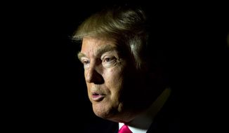 Republican presidential candidate Donald Trump speak with a members of the media Tuesday, Feb. 2, 2016, in Manchester, N.H. (AP Photo/Matt Rourke)