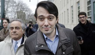 Former Turing Pharmaceuticals CEO Martin Shkreli, center, leaves court with his lawyer Benjamin Brafman, left, Wednesday, Feb. 3, 2016, in New York. Shkreli, who has become the poster child of pharmaceutical-industry greed after hiking the price of an anti-infection drug by more than 5,000 percent, is scheduled to appear at a congressional hearing on Thursday. (AP Photo/Seth Wenig)