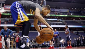 Golden State Warriors guard Stephen Curry does a dribbling drill during warms-up before the team's NBA basketball game against the Washington Wizards, Wednesday, Feb. 3, 2016, in Washington. (AP Photo/Alex Brandon)