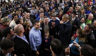 Republican presidential candidate, Sen. Ted Cruz, R-Texas, poses for photographs after a campaign event at the Johnson County Fairgrounds, Sunday, Jan. 31, 2016 in Iowa City, Iowa. (AP Photo/Paul Sancya)