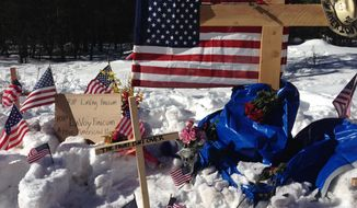 "A makeshift roadside memorial for rancher Robert ""LaVoy"" Finicum stands on a highway north of Burns, Oregon Sunday, Jan. 31, 2016. Finicum was killed Tuesday night in a confrontation with the FBI and Oregon State Police on a remote road. Four people occupying the Malheur National Wildlife Refuge held their position Sunday. They have demanded that they be allowed to leave without being arrested. (AP Photo/Nick K. Geranios)"