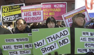 "South Korean protesters stage a rally to oppose the possible deployment of the United States' advanced defense system THAAD, a Terminal High-Altitude Area Defense, on Korea Peninsula, near the presidential house in Seoul, South Korea, Monday, Feb. 1, 2016. North Korea may be preparing to launch a rocket or missile, according to a U.S. defense official and expert analysis of commercial satellite imagery. The signs read "" Oppose the deployment of THAAD."" (AP Photo/Ahn Young-joon)"