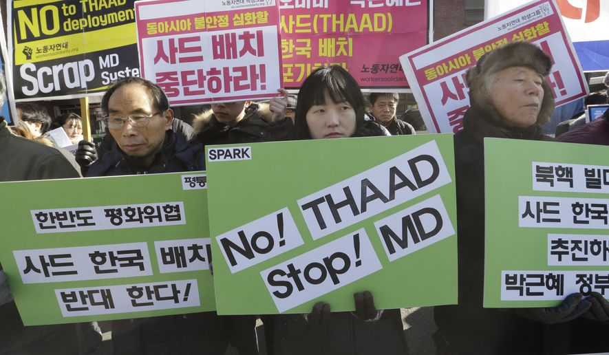 """South Korean protesters stage a rally to oppose the possible deployment of the United States' advanced defense system THAAD, a Terminal High-Altitude Area Defense, on Korea Peninsula, near the presidential house in Seoul, South Korea, Monday, Feb. 1, 2016. North Korea may be preparing to launch a rocket or missile, according to a U.S. defense official and expert analysis of commercial satellite imagery. The signs read """" Oppose the deployment of THAAD."""" (AP Photo/Ahn Young-joon)"""