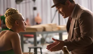 "In this image released by Universal Pictures, Scarlett Johansson, left, and Josh Brolin appear in a scene from ""Hail, Caesar!."" (Alison Rosa/Universal Pictures via AP)"