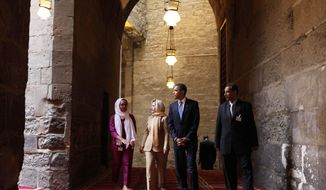 FILE - In this Thursday, June 4, 2009 file photo, U.S. President Barack Obama, 2nd right, tours the Sultan Hassan Mosque in Cairo, Egypt, with U.S. Secretary of State Hillary Rodham Clinton, 2nd left,  Iman Abdel Fateh at left and Dr. Zahi Hawass, right. Obama's first visit to a U.S. mosque comes as Muslim-Americans say they're confronting increasing levels of bias in speech and deeds. Obama is scheduled to visit the Islamic Society of Baltimore on Wednesday, Feb. 3, 2016. (AP Photo/Gerald Herbert, File)