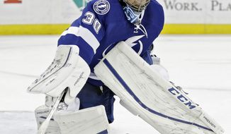 Tampa Bay Lightning goalie Ben Bishop (30) makes a save on a shot by the Detroit Red Wings during the first period of an NHL hockey game Wednesday, Feb. 3, 2016, in Tampa, Fla. (AP Photo/Chris O'Meara)
