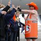 Todd McKernan, son of late Broncos Barrel Man Tim McKernan, rallies fans as they wait for the team to board a plane at Denver International Airport on its way to Super Bowl 50. (Associated Press)