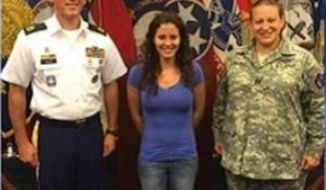 Erika Lopez (center) was the fourth woman in the country to enlist as a combat engineer in the U.S. Army (Image: local8now.com)