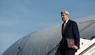 U.S. Secretary of State John Kerry gets off his plane upon his arrival at Rome's Ciampino airport Monday, Feb. 1, 2016. Kerry will be in Rome for a meeting of the core countries of the U.S.-led military coalition fighting the IS group, and will then travel to London for a conference of donors to the humanitarian effort in Syria. (Nicholas Kamm/Pool Photo via AP)