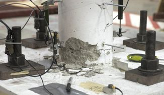 """ADVANCE FOR USE SATURDAY, FEB. 6 AND THEREAFTER - This Dec. 2, 2015 photo shows damage to the """"as built"""" column after a shake table test at the Construction Engineering Research Lab in Champaign, Ill. The lab has an earthquake simulator that can help engineers find bridge flaws.  (John Dixon/The News-Gazette via AP) MANDATORY CREDIT"""