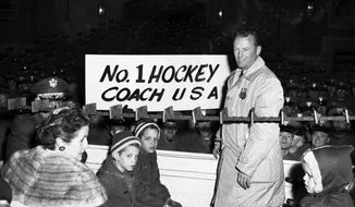 FILE - In this Feb. 29, 1960 file photo, U.S. Olympic Hockey coach Jack Riley is welcomed back to U.S. Military Academy at West Point, N.Y.  Riley, a former Army hockey coach who won guided the U.S. team to its first Olympic gold medal in 1960, has died. He was 95. The U.S. Military Academy announced in a statement that Riley died Wednesday, Feb. 3, 2016 in Massachusetts. No cause of death was provided. (AP Photo/File)