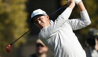 Rickie Fowler tees off on the fifth hole during the first round of the Phoenix Open golf tournament, Thursday, Feb. 4, 2016, in Scottsdale, Ariz. (AP Photo/Rick Scuteri)