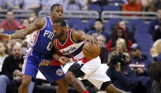 Washington Wizards guard John Wall (2) drives against Philadelphia 76ers guard Isaiah Canaan (0) during the first half of an NBA basketball game, Friday, Feb. 5, 2016, in Washington. (AP Photo/Alex Brandon)