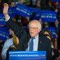 Democratic presidential candidate, Sen. Bernie Sanders, I-Vt,  waves to the crowd at his caucus night rally in Des Moines, Iowa, Monday, Feb. 2, 2016.  (AP Photo/J. David Ake)