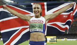 FILE - This is a Sunday, Aug. 23, 2015 file photo of Gold medalist Britain's Jessica Ennis-Hill as she celebrates after the heptathlon 800m at the World Athletics Championships at the Bird's Nest stadium in Beijing.  Olympic heptathlon champion Jessica Ennis-Hill will miss the 2016 indoor athletics season because of an Achilles injury sustained in training.  (AP Photo/Lee Jin-man, File)
