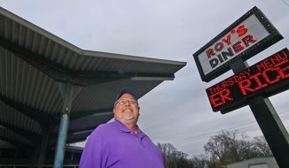 ADVANCE FOR SATURDAY, FEB. 6, 2016- In this photo taken on Jan. 21, 2016, owner Roy Etheridge stands outside Roy's diner in Anderson, S.C. The restaurant has been open since 1979. (Ken Ruinard /The Independent-Mail via AP) SENECA NEWS OUT; MANDATORY CREDIT