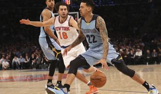Memphis Grizzlies forward Matt Barnes (22) drives past New York Knicks guard Sasha Vujacic (18) during the first half of an NBA basketball game, Friday, Feb. 5, 2016, at Madison Square Garden in New York.  (AP Photo/Mary Altaffer)