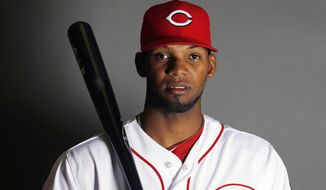 This is a 2015 photo of Juan Duran of the Cincinnati Reds. Cincinnati Reds outfield prospect Juan Duran has been suspended for the first 80 games of the season under Major League Baseball's drug program following a positive test for three performance-enhancing substances, Friday, Feb. 5, 2016.(AP Photo/John Locher)