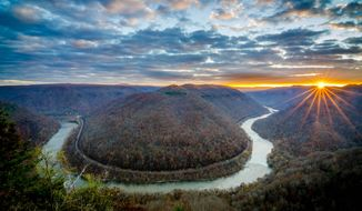 ADVANCE FOR SUNDAY FEB. 7, 2016 AND THEREAFTER This Friday Jan. 29, 2016 photo provided by Melvin Hatley shows a view of daybreak over the New River Gorge from a vista along Grandview Rim Trail greeted Fayetteville, W.Va., Hartley became the first person to complete the New River Gorge 100 Mile Challenge, doing so in just 14 days.  (Melvin Hatley via AP)