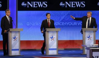 Republican presidential candidate, former Florida Gov. Jeb Bush and Republican presidential candidate, businessman Donald Trump spar as Republican presidential candidate, Sen. Marco Rubio, R-Fla., listens in the middle during a Republican presidential primary debate hosted by ABC News at the St. Anselm College Saturday, Feb. 6, 2016, in Manchester, N.H. (AP Photo/David Goldman)