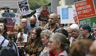 Protestors against asylum seekers being deported, gather for a rally in Sydney, Australia, Thursday, Feb. 4, 2016. Australia was resisting mounting international pressure not to deport child asylum seekers, with a minister warning on Thursday that allowing them to stay could attract more refugees to come by boat. (AP Photo/Rob Griffith)