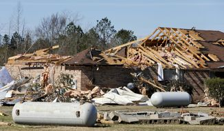 A home on Sapps Road shows heavy damage from and EF-2 tornado that struck in rural west Alabama in the Sapps Community in Pickens County.  Residents and volunteers were working to clear debris and salvage belongings Friday, Feb. 5, 2016. (Gary Cosby Jr.,/The Tuscaloosa News via AP) ** FILE **