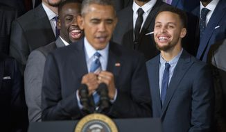 Golden State Warriors players, Draymond Green, left, and Stephen Curry, right, reacts to watching President Barack Obama, center, mimicking Curry's 'clowning' on the basketball court, during a ceremony honoring the 2015 NBA Champions during a ceremony in the East Room of the White House in Washington, Thursday, Feb. 4, 2016. (AP Photo/Pablo Martinez Monsivais)