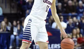 Connecticut's Kia Nurse (11) dribbles during the first half of an NCAA college basketball game against East Carolina in Storrs, Conn., on Saturday, Feb. 6, 2016. (AP Photo/Fred Beckham)