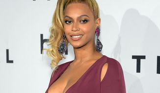 """FILE - In this Oct. 20, 2015 file photo, singer Beyonce arrives at TIDAL X: 1020 Amplified by HTC at the Barclays Center in New York. A day before her performance at Sunday's Super Bowl halftime show, Beyonce has dropped a new song. Beyonce released """"Formation"""" on Saturday, Feb. 6, 2016 as a free download on her artist page for the streaming service, Tidal, which she co-owns with husband Jay Z, Rihanna and other artists.(Photo by Evan Agostini/Invision/AP, File)"""