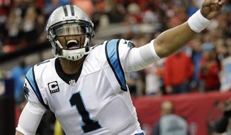 FILE - In this Dec. 27, 2015, file photo, Carolina Panthers quarterback Cam Newton celebrates his touchdown against the Atlanta Falcons during an NFL football game in Atlanta. Newton's spectacular season has earned him The Associated Press NFL Offensive Player of the Year award. (AP Photo/David Goldman, File)