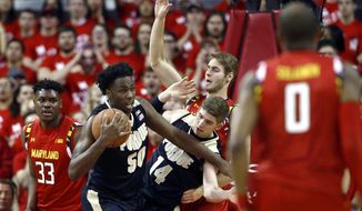 Purdue forward Caleb Swanigan (50) grabs a rebound in front of teammate Ryan Cline (14), Maryland center Diamond Stone (33) and Maryland forward Jake Layman, back right, in the first half of an NCAA college basketball game, Saturday, Feb. 6, 2016, in College Park, Md. (AP Photo/Patrick Semansky)
