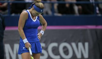 Svetlana Kuznetsova, of Russia, reacts loosing a point to Richel Hogenkamp, of the Netherlands, during their Fed Cup tennis match between Russia and Netherlands in Moscow, Russia, on Saturday, Feb. 6, 2016. (AP Photo/Ivan Sekretarev)
